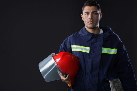 Fireman holding a safety helmet