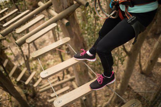 Woman on zipline in adventure park