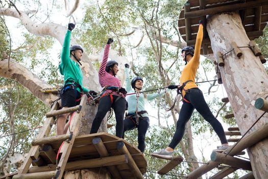 Friends having fun in adventure park