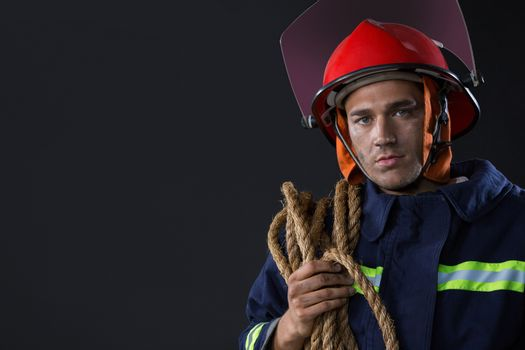 Fireman standing with a rope