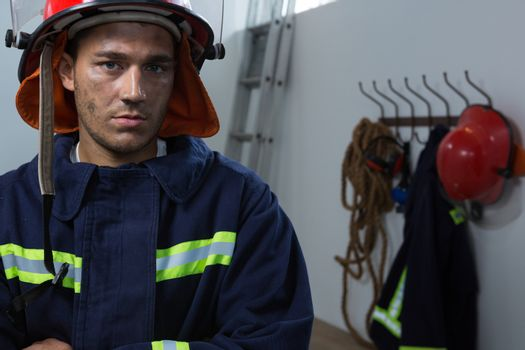 Exhausted fireman standing in the office