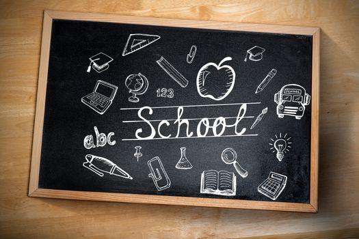 Composite image of education doodles against chalkboard