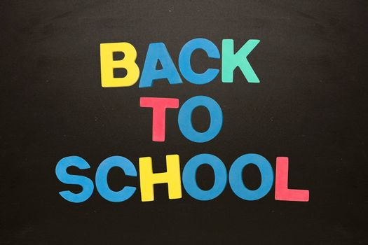 Colourful back to school message on blackboard