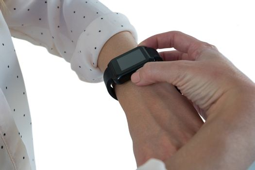 Female executive using smartwatch