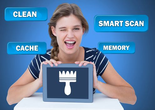 Woman holding tablet with Clean cache scan buttons and brush