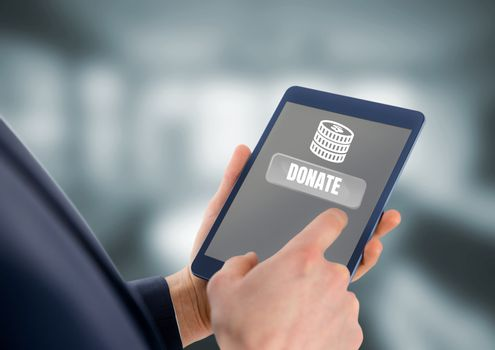 Person holding tablet with donate buttonf and money for charity