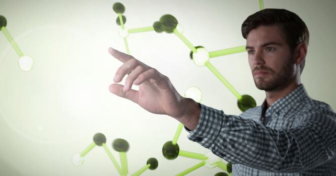Businessman touching air in front of science micro organisms