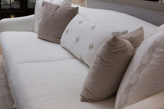 Close-up of cushions arranged on sofa