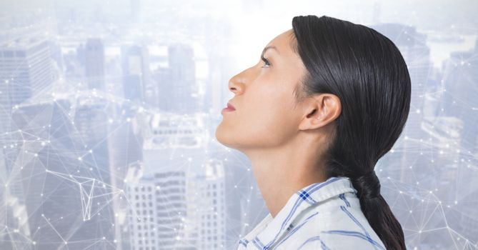 Woman looking up with interconnected city background