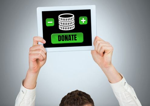 Man holding tablet with donate button and money for charity