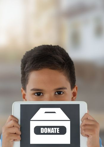 Boy holding tablet with donate box icon for charity
