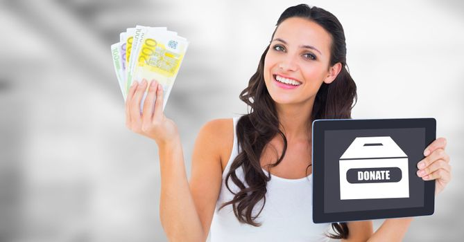 Woman holding tablet with donate box and money notes