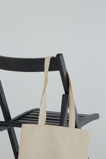 Grocery bag hanging on black chair