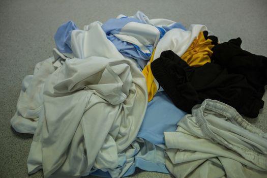 Dirty football jersey on floor
