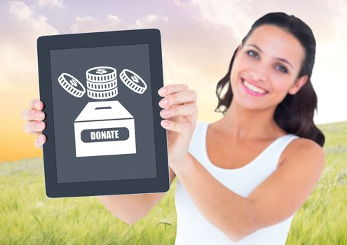 Woman holding tablet with donate box and money icon for charity