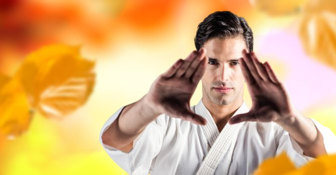 Man practicing martial arts face in forest