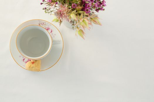 Empty cup and saucer with sweet food