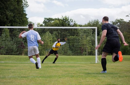 Goalkeeper diving to save the goal