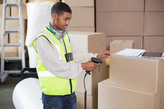 Warehouse worker scanning a box
