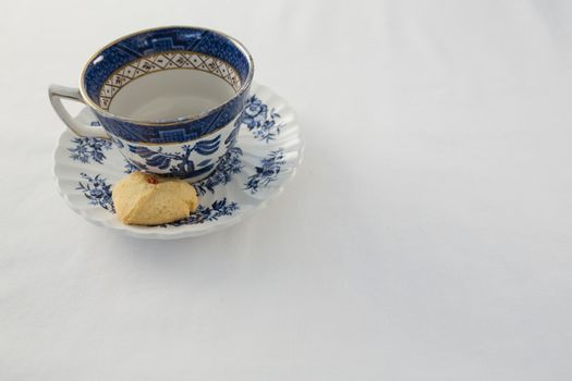 Empty cup with saucer and sweet food