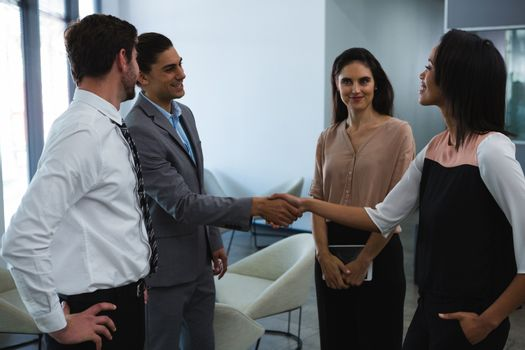 Business colleagues interacting with each other
