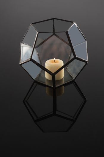 Lit candle on candle holder