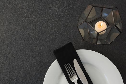 Table setting with lit candle