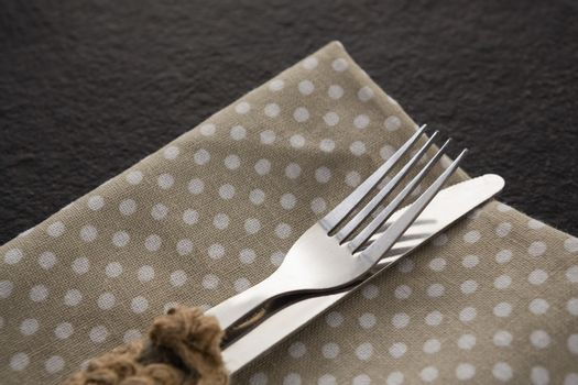 Fork and knife on a dotted napkin