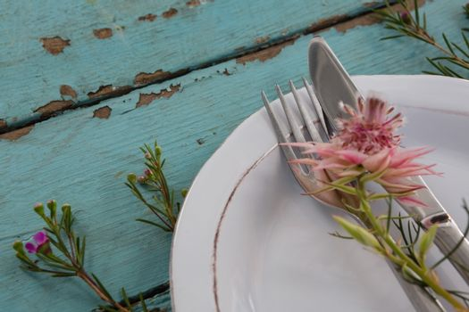 Cutlery with flower in a plate