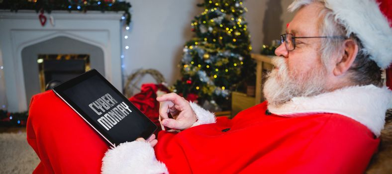 Title for celebration of cyber Monday  against santa claus using digital tablet