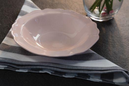 Pink bowl on folded napkin