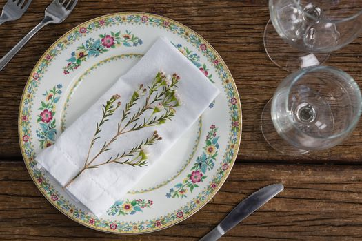 Flower with napkin on a plate