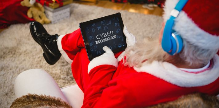 Title for celebration of cyber Monday  against santa claus using digital tablet at home
