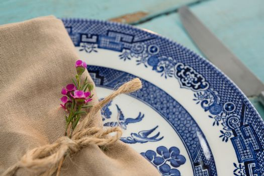 Tied napkin with flora on plate