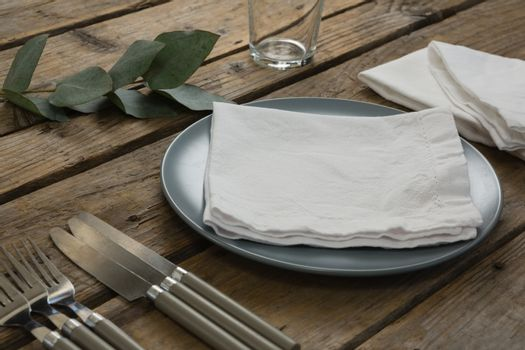 Plate with cutlery set and napkin