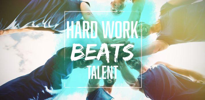 Composite image of hard work beats talent