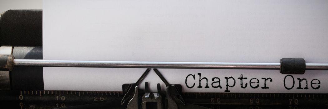 New chapter  against close-up of typewriter