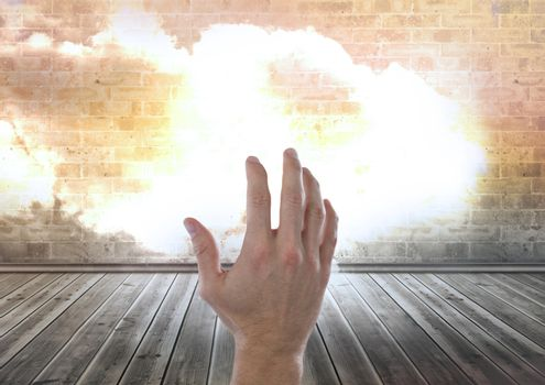 Hand reaching with cloud in room