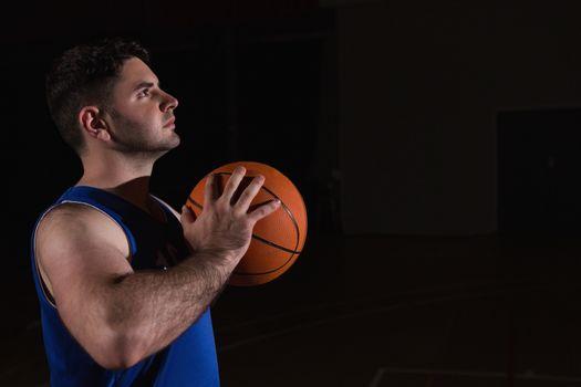 Player ready to throw basketball