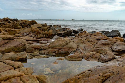 Rose granit sea shore in Britanny travel and hiking