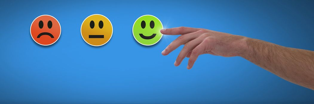 Hand pointing at feedback smiley faces satisfaction