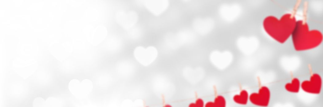 Digital composite of Valentines hanging love hearts background