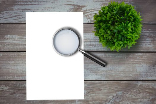 Magnifying glass on paper