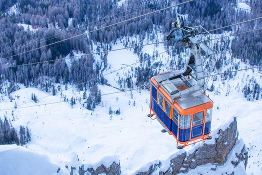 Gondola lift cable car on ski resort Cortina d'Ampezzo winter city view from Faloria ski area