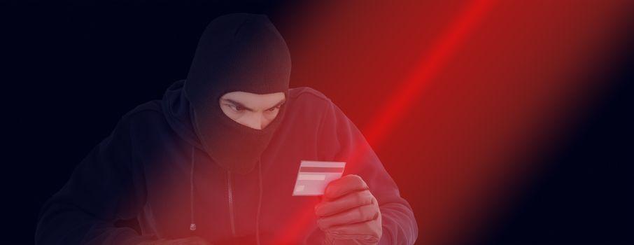 Focused burglar using computer and debit card