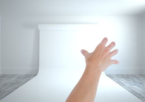 Hand reaching with paper on wall