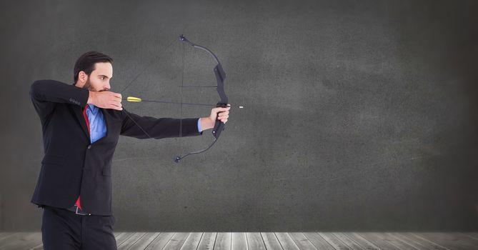 Businessman shooting arrow