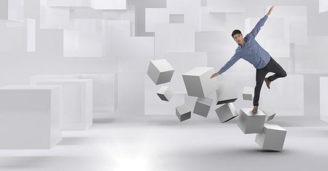 Man balancing on geometric surreal cubes