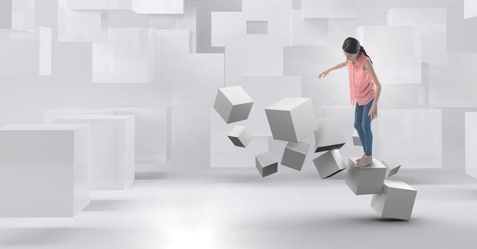 Woman balancing on geometric surreal cubes