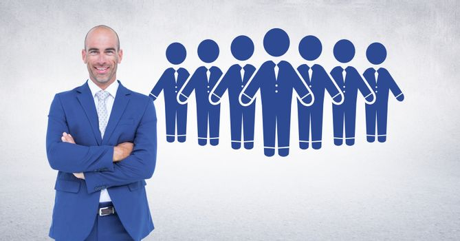Digital composite of Businessman folding arms with people group icons